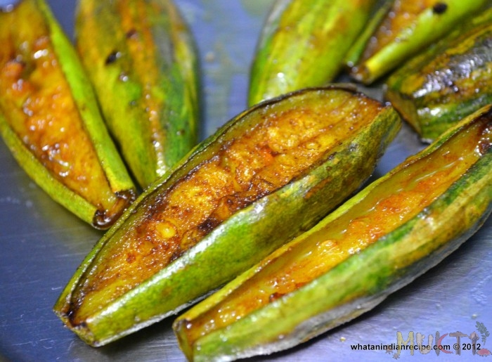 Fried Patol, or pointed gourd. Parval in Hindi.